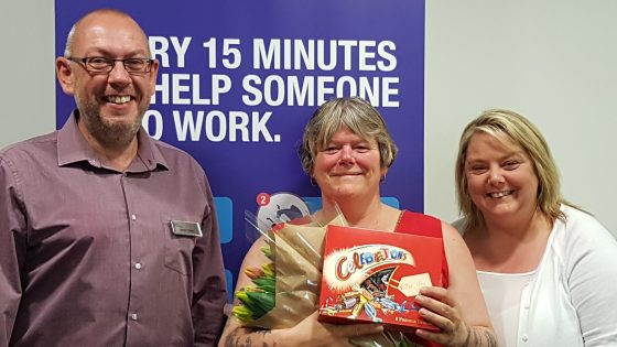 Lillian Youles (centre) is congratulated by the Work Routes team